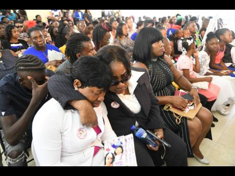 Cyrena Russell (left), mother of Shantell Whyte, being comforted during the thanksgiving service for her daughter at the Royal Flat Seventh-day Adventist Church in Manchester on Sunday.