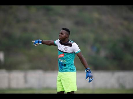 Cavalier's goalkeeper Jeadine White barks out instructions during a Red Stripe Premier League match against UWI FC at the Mona Bowl on Sunday. Cavalier won 3-0.
