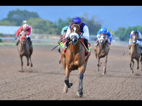 ENGLAND ROSE (centre) ridden by Jockey Omar Walker, winning the Hot Line Stakes over 1200 metres at Caymanas Park on Saturday, February 22, 2020.