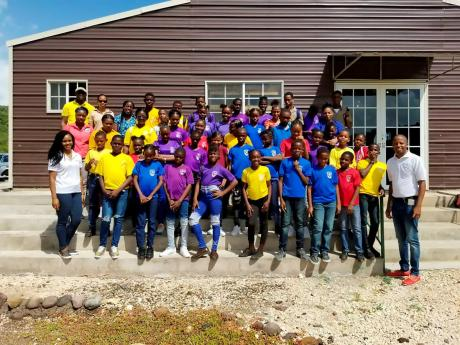 Students and teachers of Greenwich All-Age and Haile Selassie High schools take a photo moment while on tour of the Portland Bight Disocovery  Centre.