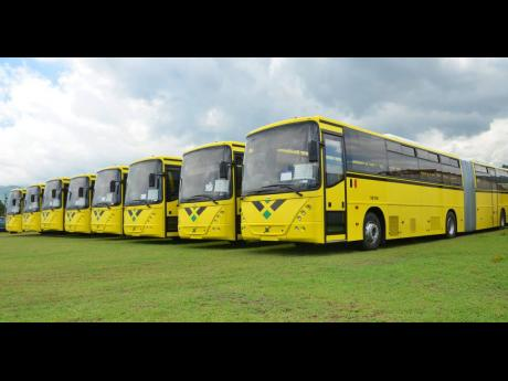 Regular JUTC articulated buses parked on their arrival in Kingston in 2018. JUTC and New Fortress Energy are pilot testing five buses powered by compressed natural gas. The regular fleet runs on diesel.