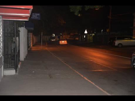 A vehicle drives along Gloucester Avenue in Montego Bay at night ime. The new Perimeter Road under consideration proposes to bypass the strip.