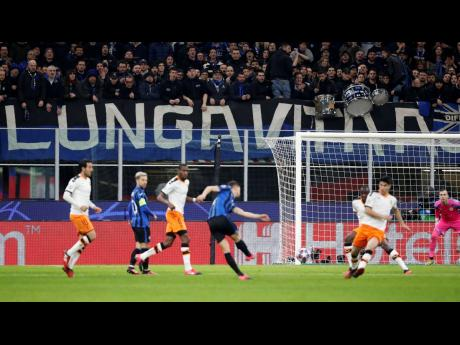 Spectators sit in the stands during the UEFA Champions League round of 16, first leg, match between Atalanta and Valencia at the San Siro Stadium in Milan, Italy on Wednesday, February 19.