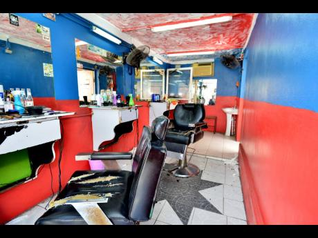 An empty barbershop is seen on Monday, March 23, 2020 in Spanish Town. The personal care sector has seen a large reduction in business under the shutdowns to contain the spread of the coronavirus