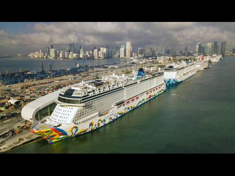 The Norwegian Encore cruise ship is docked at the Port of Miami on Thursday, March 26, 2020, in Miami, Florida.