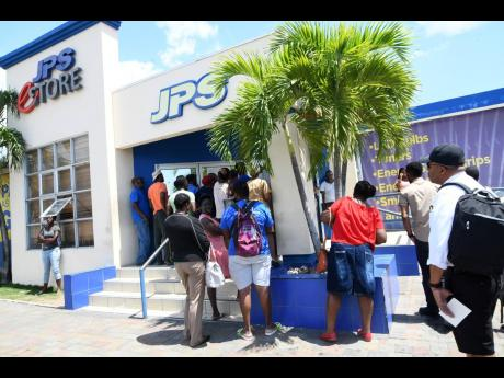 Customers waiting to access the JPS office at Ruthven Road, St Andrew last week. The company implemented social distancing measures as part of the Government's strategy to curtail the spread of COVID-19.