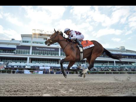 AP Tiz the Law, ridden by Manuel Franco, wins the Florida Derby  at Gulfstream Park in Hallandale Beach yesterday.