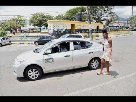 In this March photo, a female was turned away by the taxi driver as she would have been the fourth passenger in a cab which runs from Papine to downtown Kingston.