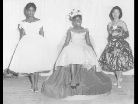 Miss Daphne Adams (centre) wears her new crown as the University College of the West Indies (UCWI) Campus Queen 1958, at the Dramatic Theatre. At left is second-prize winner Miss Helen Scott and at right is third prizewinner, Miss Joyce Chung, also of the Faculty of Arts.