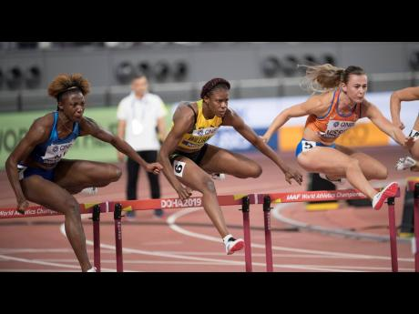 Jamaica's Danielle Williams (centre) is flanked by Nadine Visser (right) of the Netherlands and eventual champion Nia Ali of the USA during the first semi-final of the women's 100m hurdles at the World Athletics Championships in Doha, Qatar, on Sunday, October 6, 2019.