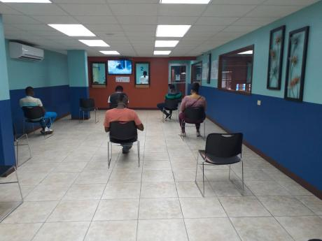 Social distancing being practised in the customers' waiting area of a member company of the Shipping Association of Jamaica.