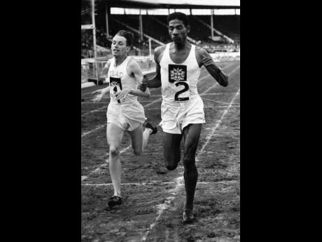 In this August 1949 file photo, Jamaica's Arthur Wint (right) defeats Great Britain's John Parlett in the 880-yard event during the British Games at White City Stadium in London, England.