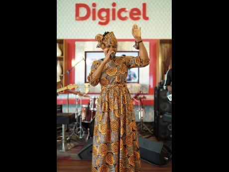 Minister Marion Hall lifts her hand in praise during her soul-stirring performance on the Digicel Unplugged stage.