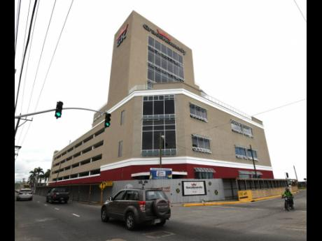 File The GraceKennedy building in downtown Kingston. In normal times, the conglomerate would have open-door annual general meetings at its corporate headquarters, but this year it was a closed-door event.