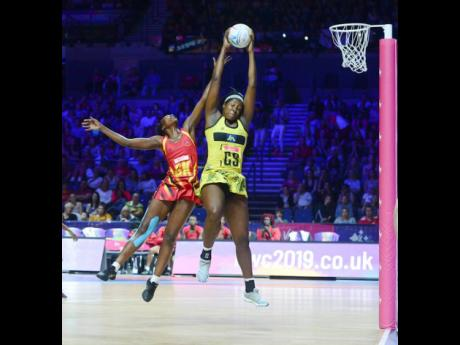 Jamaica's Jhaniele Fowler (right) outjumps Uganda's Muhayimina Namuwaya to collect a pass during the Netball World Cup at the M&S Bank Arena in Liverpool in 2019. Jamaica won 61-48.