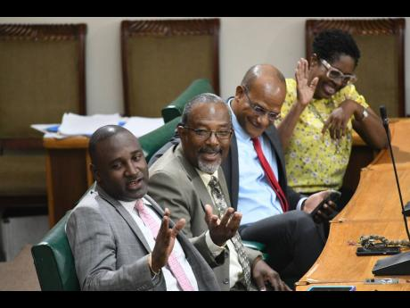 Peter Bunting (second right) in a joyful mood with parliamentary backers from his failed presidential bid, Dr Dayton Campbell (left), Luther Buchanan and Angela Brown Burke, in the House of Representatives on Tuesday, October 8, 2019.