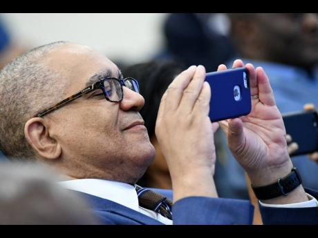 File  Brian Wynter, former central bank governor now adviser to NCB Financial Group. Wynter is seen here taking a photo at a seminar on June 13, 2019.