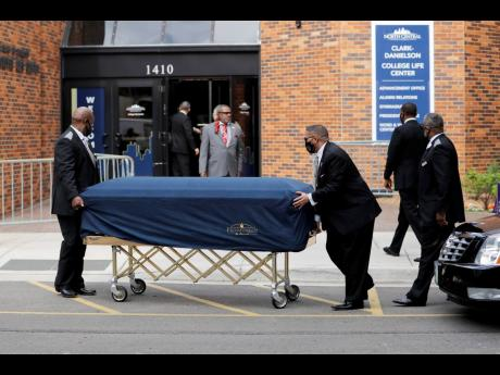 The body of George Floyd arrives before his memorial service in Minneapolis yesterday.