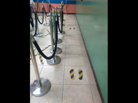 Adolph Levy's social-distancing floor markers for customers.