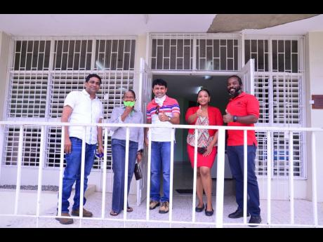 Team AIS (from left) Shekar Reddy, business development manager; Stacey Hallsal-Peart, chief operating officer; Rukesh Kumar Patel; Kaylia Spence, LIMS specialist; and Jomo Blake, tech support officer, stand proudly as they all performed an act of solidari