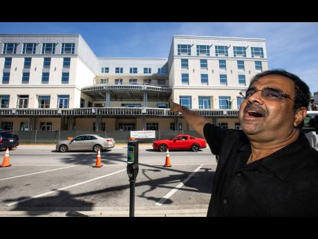 In this October 23, 2019, file photo, developer Danny Gaekwad talks about the roof-top bar on his Hilton Garden Inn hotel, which is currently under construction in Ocala, Florida.