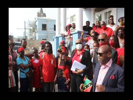 Opposition Leader Dr Denzil Douglas (right, foreground) announcing that his party has filed petitions challenging the June 5 general election.