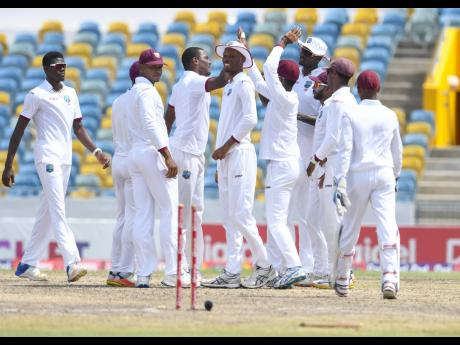 West Indies  celebrate a Pakistan wicket during the Brighto Paints Q Mobile Cup second Test against Pakistan at Kensington Oval, Barbados, in 2017.