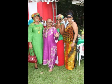 From left, Sharon Tucker, Dr L'Antonette Stines, Mama Joy and Sharon Reuben strike a regal pose on the lawns of the Jamaica Pegasus Hotel on International Reggae Day 2010.