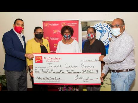 From left: Nigel Holness, managing director of CIBC FirstCaribbean International Bank,  and Jerome Griffith, human resource manager at the bank, present the CIBC FirstCaribbean Walk For The Cure cheque for $4.533 million to Elve Passley, administrative ass
