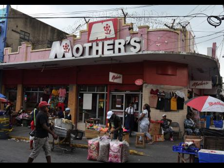 Hawkers vend outside a Mother's restaurant at the intersection of Orange and Beckford streets in downtown Kingston. Restaurants will be able to accommodate diners as of today as coronavirus restrictions are relaxed.