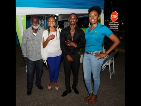 Jacqueline Donaldson (right), vice-president, corporate services, Sagicor Group Jamaica, pauses for a photo with (from left) Freddie McGregor, Carlene Davis and Christopher Martin during the show.