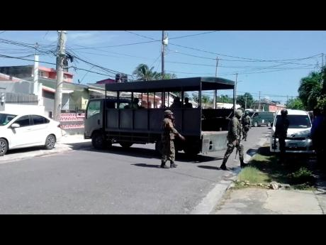 Detectives of the Counter Terrorism and Organised Crime Unit and members of the Jamaica Defence Force carry out an operation in St James on Wednesday morning.