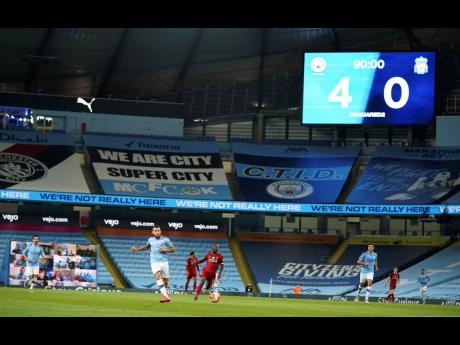 The scoreboard at the Etihad Stadium in Manchester, England, shows the final score during the English Premier League match between Manchester City and Liverpool yesterday.