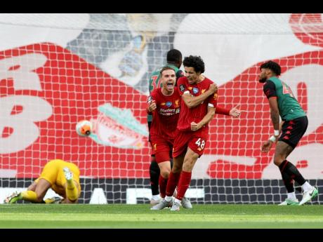 Liverpool's Curtis Jones (Number 48) celebrates after scoring his side's second goal during the English Premier League match against Aston Villa at Anfield Stadium in Liverpool, England, yesterday.