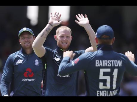 England's Ben Stokes (centre) celebrates dismissing West Indies' Shai Hope during the second One-Day International cricket match at the Kensington Oval in Bridgetown, Barbados, on Friday, February 22, 2019.