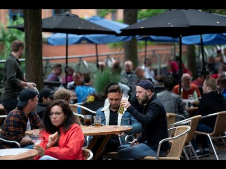 Members of the public are seen at a bar on Canal Street in Manchester, England, on Saturday.