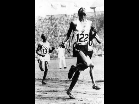 Arthur Wint winning Jamaica's first Olympic gold medal at the 1948 Games.