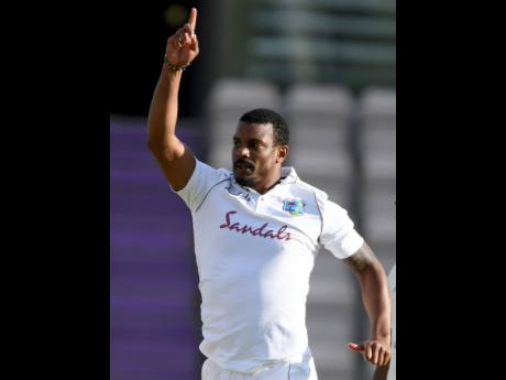 West Indies' Shannon Gabriel celebrates the dismissal of England's Ollie Pope during the fourth day of the first cricket Test match between England and West Indies, at the Ageas Bowl in Southampton, England, yesterday.