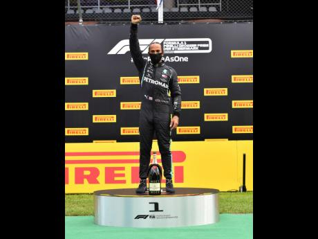 Mercedes driver Lewis Hamilton of Britain celebrates on the podium after winning the Styrian Formula One Grand Prix at the Red Bull Ring racetrack in Spielberg, Austria, yesterday.