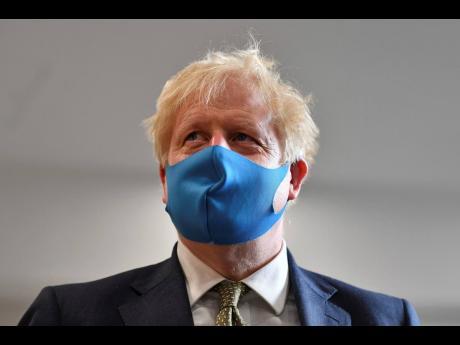 Britain's Prime Minister Boris Johnson wearing a face mask.