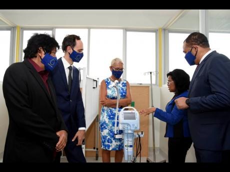 Head of the European Union (EU) Delegation to Jamaica, Ambassador Malgorzata Wasilewska (centre), listens as Dr Michelle-Ann Dawson (second right), senior medical officer of the Bustamante Hospital for Children, discusses the functions of a ventilator insi