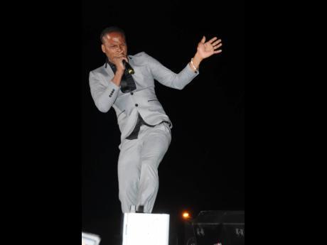 'Breaking News' singer Dexta Daps entertains an attentive audience on dancehall night of Reggae Sumfest 2018.