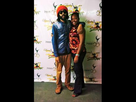Dr Susaye Rattigan with reggae artiste Protoje after his performance at Reggae Sumfest 2012.