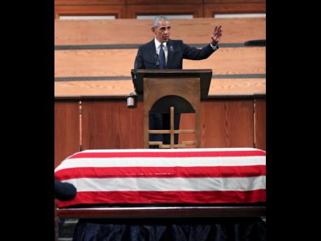 Former President Barack Obama addressing the funeral for the late Republican John Lewis at Ebenezer Baptist Church in Atlanta yesterday.