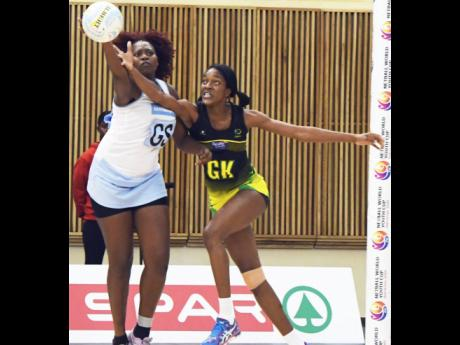 Jamaica goal keeper Kadie-Ann Dehaney (right) competes with Botswana's Chelido David during their Netball World Youth Cup match at the University of Botswana in Gaborone, Botswana on Tuesday, July 11, 2017.