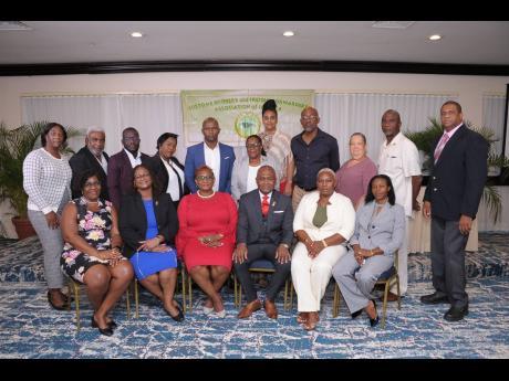 The CBFFAJ executive body for 2020-21. Front row (from left): Margaret Sharpe, honorary secretary; Mitzie Gordon Burke-Green, immediate past president; Hazelyn Brown, vice-president; Clive W. Coke, president; Susan Neil, vice-president; Ann Brown-Chang, vi