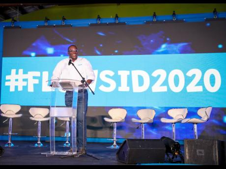 In this February 11, 2020 photo, FLOW Jamaica Country Manager Stephen Price addresses the Safer Internet Day Teen Summit hosted by FLOW in Kingston. The company has been losing customers due to the pandemic, leading to lower revenue.