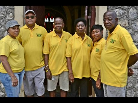 In this 2017 photograph, members of Beecher Town Give Back Association smile for the camera during a health fair in Beecher Town, St Ann. From left are: Fay Grocia, president; Audley Codner; Sidney Brown, treasurer; Blanche Rattigan-Cummings; Mornice Mille