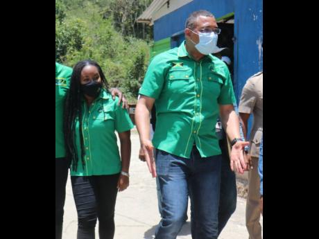 Senator Tova Hamilton (left) and Prime Minister Andrew Holness tour the community of Davis Pen, Trelawny. The Jamaica Labour Party leader was on the Trelawny leg of his western Jamaica tour.