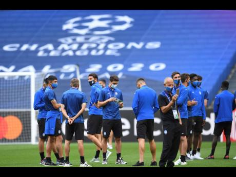 Atalanta players during a team walk around at the Luz stadium in Lisbon, yesterday. Atalanta will play PSG in a Champions League quarter-finals match today.